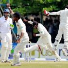 Sri Lanka captain Mahela Jayawardene (R) celebrates their win after England's last batsman, Monty...