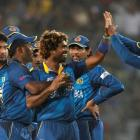 Sri Lanka's Lasith Malinga (3rd R) is congratulated by teammates after he dismissed West Indies'...