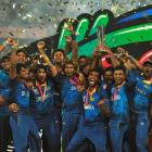 Sri Lankan players celebrate with the trophy after winning the ICC Twenty20 World Cup. REUTERS...