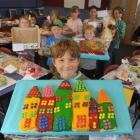St Clair School pupil Quinn Shaw shows off the Italian cake he baked for the school fair today....