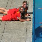 St Clair Surf Life Savers Brooke Cox (21), front, and Ana Keelty (20)  watch a 2-year-old male...