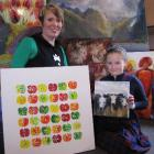 St Joseph's School PTA Art Auction founder and curator Louise Ward and daughter Lucy (8) with...