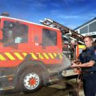 St Kilda firefighter Jason Morey celebrates the opening of the newly renovated St Kilda Fire...