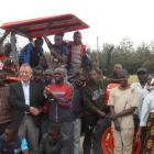 Staff and pupils at an agricultural training farm in Kenya with a new tractor, bought with New...