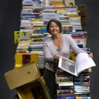 Star Regent 24 Hour Book Sale organiser Alison Cunningham leafs through one of the thousands of...