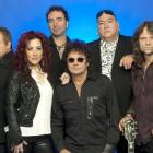 Starship, featuring Mickey Thomas (front centre) with (from left) backing singer and bass player...