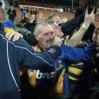 Stephen Barnes greets Otago flanker Willis Scott (right, obscured) after Otago beat Waikato 26-19...