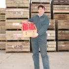 Stephen Darling, at his Teviot packhouse with a box of New Zealand rose apples, bound for...