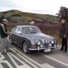 Steve McNulty's 1965 Jaguar is put to the test during the last quarter-mile sprint held along...