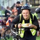 Steve Walker, of Port Chalmers, enjoys a free breakfast in the Octagon yesterday. PHOTO: PETER...