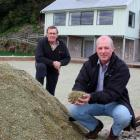 Stewart Island Bowling Club member Alister Eade (left) and Southland District Council Stewart...