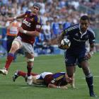 Stormers player Sireli Naqelevuki, right, runs with the ball as  Highlanders players give chase. ...