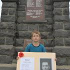 Strath Taieri School pupil William Tisdall holds a picture of fallen Gallipoli soldier Arthur...