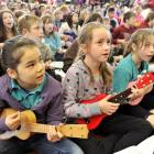 Strumming along during the Ukulele Kids' Jam at St Clair School are Balaclava School pupils (from...
