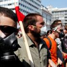 Student protesters march during a demonstration against austerity measures in Athens' Syntagma ...