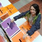 Student Shonelle Eastwood casts her vote early at an advance voting booth set up at the...