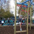 Student teacher Jacqui Lammers tests out the new playground at Goldfields School on Thursday. She...