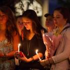 Students and staff members attend a candle light vigil on Boston University Campus in Boston,...