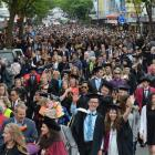 Students stream  down George St towards the Dunedin Town Hall during Saturday's graduands  parade.