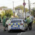 Students talk to Dunedin police after a brawl in Hyde St involving up to 50 people last night....