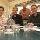 Studying the information on ways to improve Alexandra's water quality and supply are (from left)...