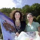 Summer Forgie (left) and Waitaki Resource Exchange co-ordinator Maxine Woodhouse use discarded...