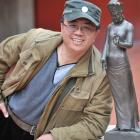 Sun Qi (52) with one of his bronze figurines that represent the search for serenity through faith...