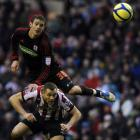 Sunderland's Phil Bardcsley (bottom) challenged by Middlesbrough's Lukas Jutkiewicz during their...