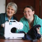 SuperGran Judy Breward (76, left) helps Michelle Whittaker (25) fix a pair of pants, in Dunedin....