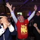 """Supporters from the """"No"""" Campaign react to a declaration in their favour, at the Better Together..."""