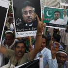 Supporters of former president Pervez Musharraf chant slogans on Sunday in Karachi, during a...