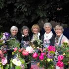 Supporters of the Anglican parish market day selling beautiful flowers are (from left) Glenys...