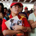 Supporters of Venezuelan President Hugo Chavez  pray in a chapel outside the Caracas military...