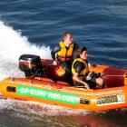 Nicky Wallace and trainee search and rescue dog Tyke take to the waves with Rhys McAlevey, of the...