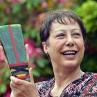 Suzanne Renner at home with her Kowhiti lifetime achievement award last week. Photo by Peter...