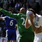 Swansea City's Angel Rangel holds his head in his shirt after a missed attempt on goal during the...