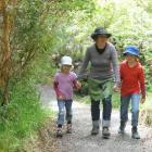 Swiss tourists Brigitte Schneider-Grimm and children Marlen (9) and Elsa Grimm (6) walk around...