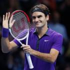 Switzerland's Roger Federer celebrates winning his men's singles semifinal against Britain's Andy...