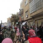 Syrian soldiers who defected to join the Free Syrian Army are seen among demonstrators during a...