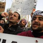Syrians who live in Greece chant slogans against Syrian President Bashar Assad during a protest...