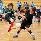 Tahuna's Damon Moss shoots past DNI goalkeeper Matt Dukes during the Otago regional futsal...