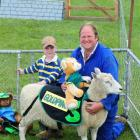 Taieri A&P Show president Kelly Allison and son Fynn (4) examine one of this year's entrants....