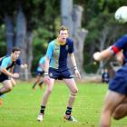 Taieri College first five-eighth Callum Smeaton waits for a pass from halfback Tane Marshall...