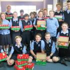 Taieri College room 7NJ pupils with their Operation Christmas Child donations.  Photo supplied.