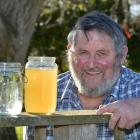 Taieri horticulturist Brian Miller with unfiltered water from his bore at right and filtered...