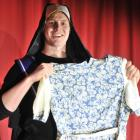 Taieri Musical Society marketing manager Ben Thomas gets to grips with some of the costume...