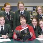 Tania Roxborogh (centre) with a copy of Banquo's Son and her Columba College advisers (front from...