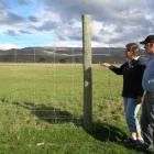 Tarras farmers Ann and Beau Trevathan look towards their neighbours' property, where the...