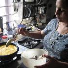 Chef Leena Sham prepares Malabar fish curry. Photo by Charmian Smith