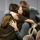 Taya Kyle (L), wife of slain Navy SEAL Chris Kyle, hugs a family member after they arrive for the...